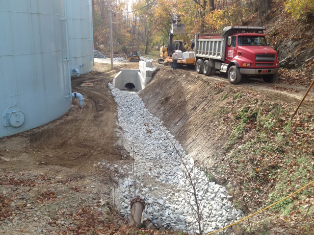 CMS completed the installation of a 58″ storm drain with two 30k lb. precast head and end walls at Columbia WTP Lockards Hollow